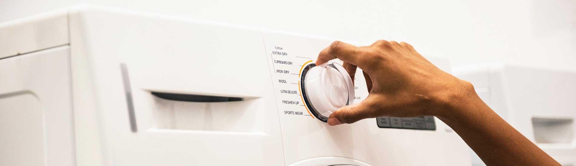 Person Turning Washer Knob